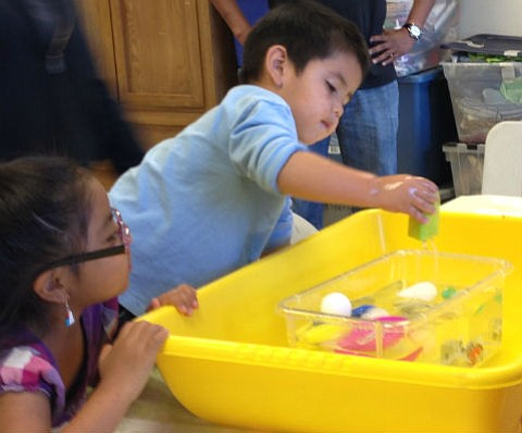 Will it sink or float? Simple and fun water games like these help build early scientific reasoning skills.