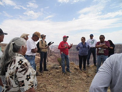 Hopi Tribal Chairman Herman Honanie speaks to a group of people opposed to the Grand Canyon Escalade Confluence Project about the Hopi Tribe's cultural, religious and sacred site concerns. Photo/Rosanda Suetopka