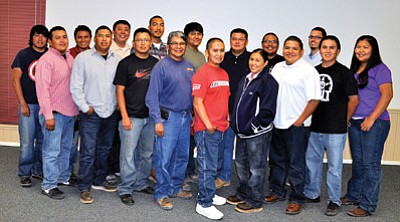 The newest graduates of Navajo Generating Station's Power Plant Fundamentals School are front row from left: Dexter Williams, Mario Gorman, Shon Redshirt, Cleveland Shortman, Michael Tsingine, Tallia Tsinnijinnie, D'Armond Chee, Jeremy Mountain and Francine Hatathlie. Back row from left: Donovan Tsinnijinnie, Jared Fowler, Orrin Billy, Cory Stingley, Bing Bizardie, Phillip Bedonie, Durwood Tallsalt and Colby Gilmore. Photo/George Hardeen