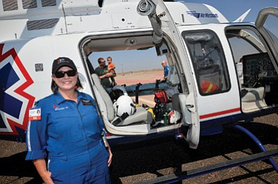Stacy Meredith, a flight nurse for Guardian Air Service based in Winslow, welcomes visitors to her office during the second annual Winslow High Desert Fly-In July 26. Photo/Todd Roth