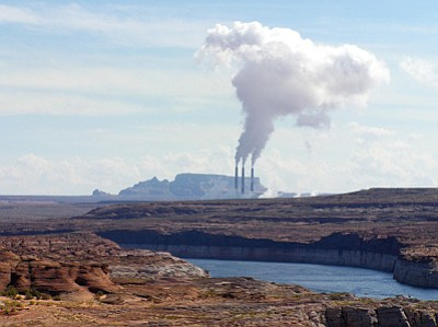 Navajo Generating Station as viewed from Glen Canyon National Recreation Area. The Environmental Protection Agency accepted a proposal that gives the plant's owners until 2030 to cut emissions by 80 percent. Photo/National Park Service