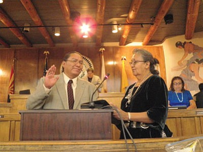 Associate Justice Eleanor Shirley Begay gives Malcolm Begay the oath of office July 23. Submitted photo