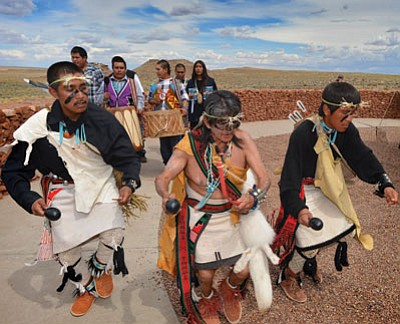 Coyote Boy dancers with drummers and singers perform at Homolovi State Park Aug. 2 during Suvoyuki Day festivities. Photo/Todd Roth