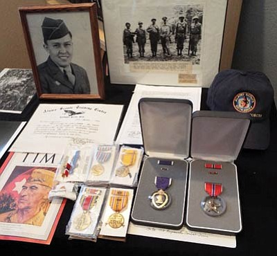 A display at the Western Agency Veterans Center in Tuba City shows a collection of medals Ssgt. Byron Tsingine earned serving in the U.S. Army. Photo/Rosanda Suetopka