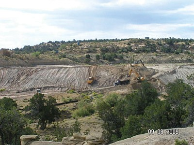 Crews clean the contaminated North East Church Rock mine on the Navajo Nation in 2009. The cleanup was part of the EPA's five-year plan meant to address the most significant issues surrounding abandoned uranium mines on Navajo lands. Photo/Environmental Protection Agency