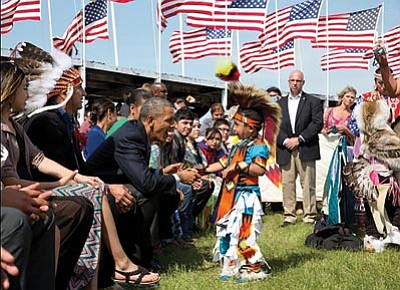 President Barack Obama greets a young boy during the Cannon Ball Flag Day Celebration at the Standing Rock Sioux Tribe Reservation in Cannon Ball, N.D., on June 13. It was the first visit by a sitting president to Indian Country in 14 years.Photo by Pete Souza/The White House