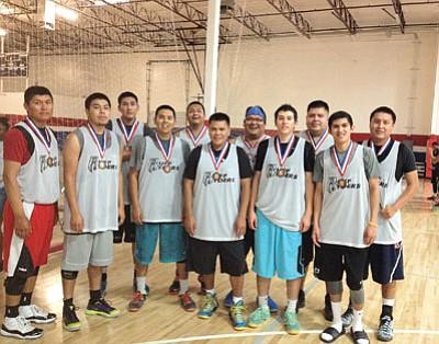 The 2014 Ruff Ryders basketball team. From left: Ryan Manheimer, Navajo, Kayenta High School and Haskell College; Samuel Hardy, Navajo/ Pima, St. Michaels High School; Marcus Begay, Navajo, Ganado High School; Tyler Tsingine, Hopi/Navajo, Flagstaff High School; Dean Tsingine, Hopi/Navajo, Tuba City High School; Derek Begay, Navajo, Greyhills High School; Olin Tsingine, Hopi/Navajo, Tuba City High School; Kurtis Silversmith, Navajo, St. Michaels High School and Scottsdale Community College; Jeffery Pourier, Oglala Lakota/Navajo, Window Rock High School; Rashaun Marin, Shoshone-Bannock, Elko High School; Donavan Begay, Navajo, Chinle High School and Haskell College.  Photo/Rosanda Suetopka