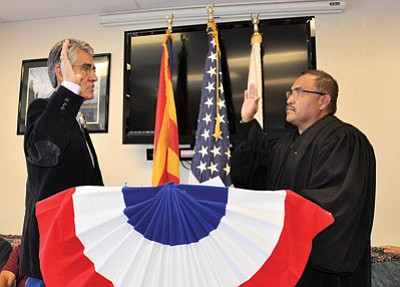 Chinle District Court Judge Victor Clyde swears in former Navajo President Joe Shirley Jr. as Apache County Supervisor Dec. 4 in Chinle, Ariz. Shirley is seeking a third term as Navajo Nation President. Photo/George Hardeen