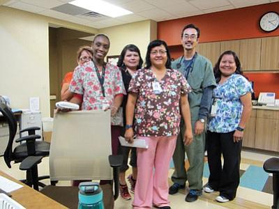 From left: Medical Receptionist Julia James, RN Aicha Kakon, Appointment Clerk Mindy Lee, RN Clarissa Nez, RN David Sullivan and CNA Christine Nez take a break in the new Winslow Indian Health Care Center building. Katherine Locke/NHO