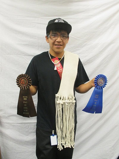 Hopi High School student Garryn Masawytewa displays awards he won at this year's Museum of Northern Arizona Hopi Festival. Submitted photo