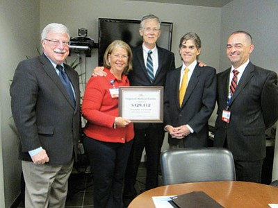 From left: USDA State Director Alan Stephens, Director of Flagstaff Medical Center's (FMC)  Telehealth Program Gigi Sorenson, CEO of Northern Arizona Healthcare Bill Bradel, FMC Interim Chief Medical Officer Mark Carroll and Verde Valley Medical Center Chief Medical Officer Harry Alberti celebrate a new grant. Katherine Locke/ NHO