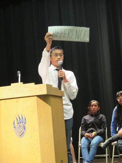 Hopi Junior High School student council candidate Allesandro Bolus campaigns for a position. Stan Bindell/NHO