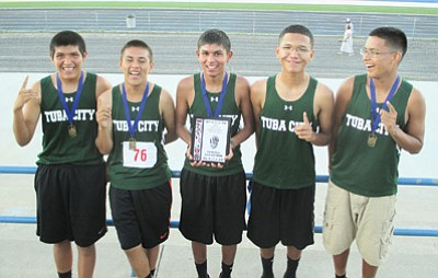 The Tuba City High School boys cross country team celebrates after winning the Hopi Invite boys race Sept. 2 at Bruins Stadium. Photo/Stan Bindell