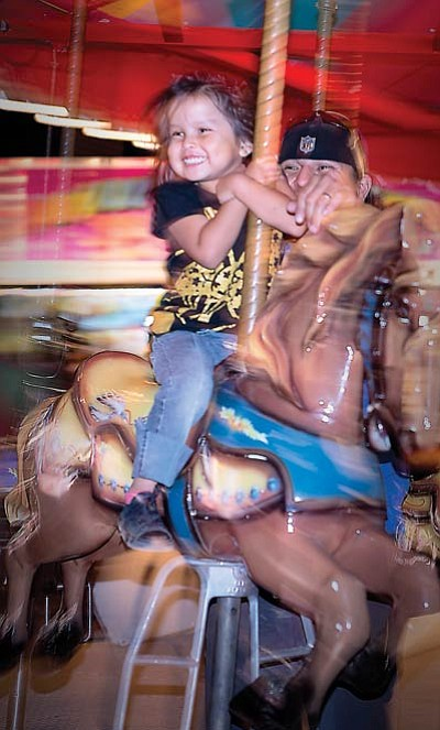 The merry-go-round is always a hit with kids and adults.  Photo/Todd Roth