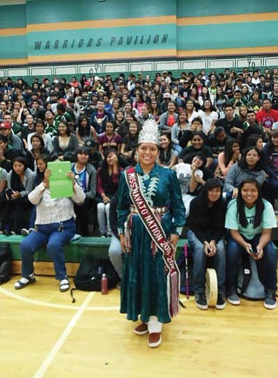 2014-15 Miss Navajo Nation McKeon Dempsey was the special guest speaker at four different Tuba City schools Sept. 19 during Native American Week. At right Dempsey begins her presentation at Tuba City High Warrior Pavilion. Photo/Rosanda Suetopka