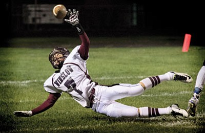 Winslow's Nick Marquez misses a low flying pass. Photo/Todd Roth