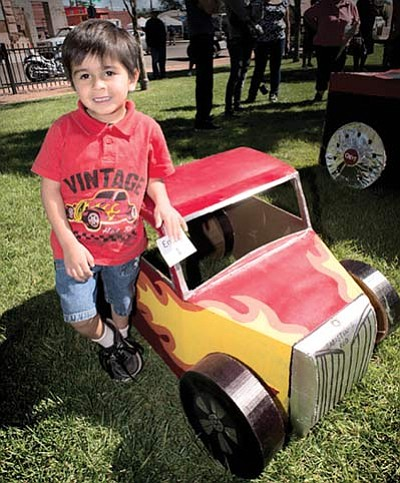 Sabastian Villaraeaz, age 4, with his cardboard car entry in Winslow Head Start's mini car show next to Car Club event. Photo/Todd Roth