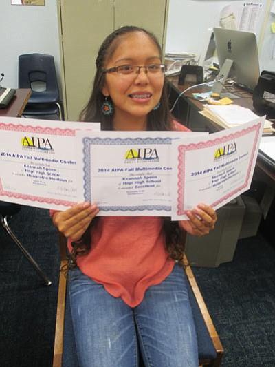 Hopi High School senior Keannah Speen displays three awards she won from the Arizona Interscholastic Press Association. Submitted photo