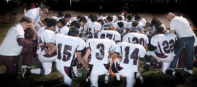The Winslow Bulldogs football team takes a knee before taking to the field against Seton Catholic Nov. 15. The Bulldogs lost 69-19 in the Division IV State Playoff matchup.   Photo/Todd Roth