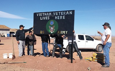 From left: Jestin Manson, U.S. Army veteran Devan Tohannie, U.S. Army veteran Lemual Adson, President of Navajo Hopi Honor Riders Larry Begay and U.S. Army veteran and Commander of the Cameron Veterans Organization Tex Walker. Walker received the most recent Honor Sign made by Tuba City High Welding students. Photo/Rosanda Suetopka