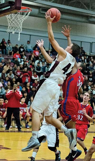 Winslow's Mark Faust lays in two points Dec. 9 against Holbrook.