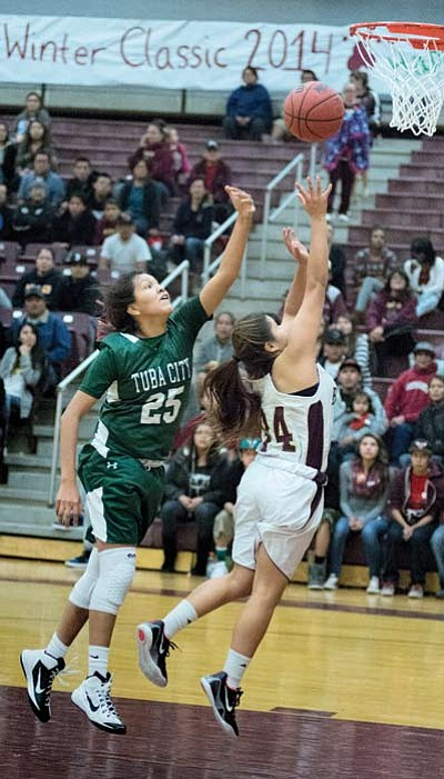 Kaelyn Bitsoi drives to the hoop for two points during the Winslow Lady Bulldogs' win against Tuba City Dec. 20 in the Wnslow Winter Classic Tourney. Photo/Todd Roth