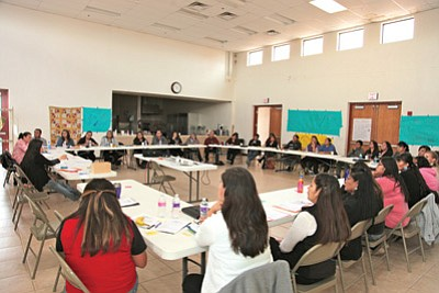 Representatives of the Hopi Department of Education, Guidance Center Programs and Northland Pioneer College, Village Youth Coordinators, Community Service Administrators, elementary school staff, school board members, Hopi Jr./Sr. High School administrators, Hopi Chairman Herman Honanie, youth participants and parents talk about issues affecting Hopi Youth Nov. 13-14 at the Hotevilla Youth and Elder Center. Photo/Stan Bindell