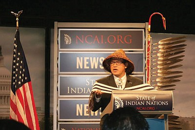 National Congress of American Indians President Brian Cladoosby holds a replica of a wampum belt at the conclusion of his State of Indian Nations address. Photo/Miranda Leo