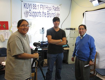 Hopi High School video news team photographer Tierra Lomabalaquihoya (left) and newscaster Star Not-Afraid interview Hopi Tribal Chairman Herman Honanie. Photo/Stan Bindell