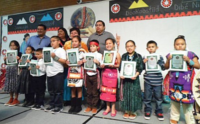Students accept awards for outstanding Native language work in December 2014. Photo/Rosanda Suetopka