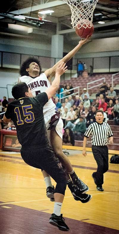 Winslow Bulldogs Devon Flanagan drives hard to the basket during Winslow's win against Blue Ridge Jan. 23. Photo/Todd Roth