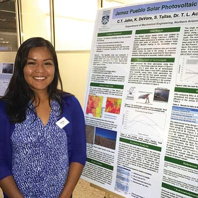Northern Arizona University mechanical engineering graduate student Cherise John displays her research poster for a project helping the Jemez Pueblo provide energy to the reservation. Courtesy photo