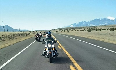 Navajo Hopi Honor Riders escort U.S. Navy veteran Orrin Chimerca from Flagstaff to his home village of Upper Moencopi-Tuba City for final burial Feb. 16. Photo/Rosanda Suetopka