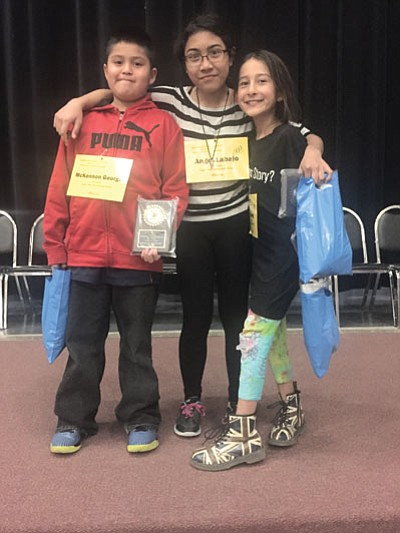 From left: fourth grade spelling winner McKennon George, sixth grade spelling winner Angel Labajo and fifth grade spelling winner Mica Song. Photo/Rosanda Suetopka