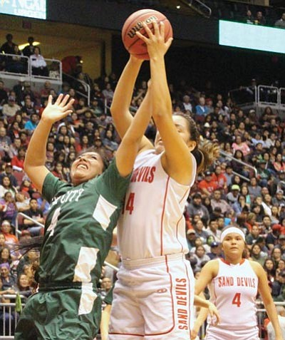 Tuba City's Samytha Parrish (4) and Page's Kaitlynn Begay (44) battle for a rebound during the 2015 Arizona AIA Division III State championship game at Gila River Arena in Glendale, Arizona Feb. 28. Photo/Anton Wero