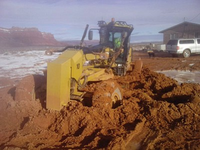Navajo Nation President Ben Shelly encourages tribal members to be patient and allow mud to dry to prevent trucks and heavy equipment from getting stuck in the mud. Submitted photo
