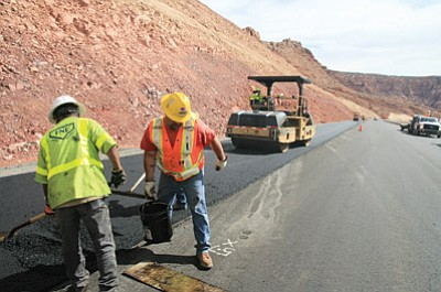 Above and below: Arizona Department of Public Safety (ADOT) crews pave a 500-foot section of U.S. 89. Photo/ADOT