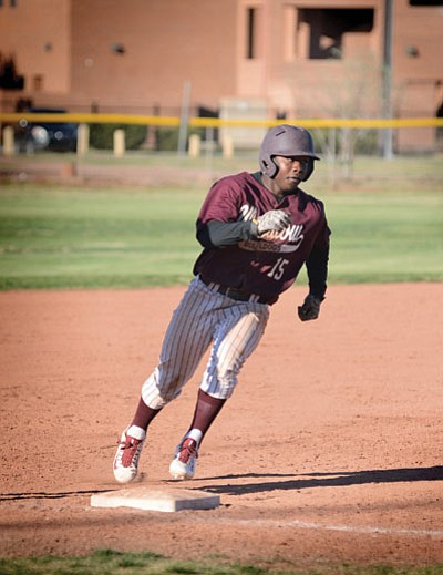 Darrien Brown crosses third base on his way to score. Photo/Todd Roth