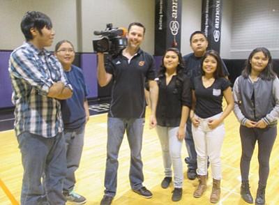 "Hopi High media students with Phoenix Suns videographer Robert Weinert. The Hopi High students are from left Star Not-Afraid,Tierra ""Terror"" Lomabalaquihoya Brenda Dacawyma, Raicardo Jim, Shanice Sakeva and Kursheena Yazzie.  Photo/Stan Bindell"
