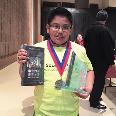 Eagles Nest Intermediate School sixth grade student Geronie Pesodas took first place in his division at the Navajo Nation Science Fair Competition in Churchrock, New Mexico. Photo/Rosanda Suetopka