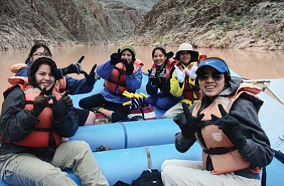 Tuba City students take a break from paddling on the Colorado River in the Grand Canyon to enjoy the view in March while on a river trip with the Grand Canyon Youth program. Photo/Walt Carr