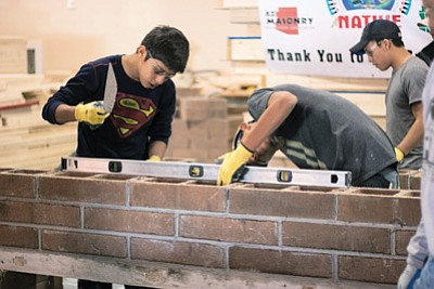 Tuba City High Career Technical Education program students learn how to level, plumb and range during a recent masonry workshop. Photo/Rosanda Suetopka