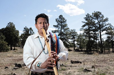 Jonah Littlesunday finds inspiration while playing his flute at Buffalo Park in Flagstaff, Arizona. Ryan Williams/NHO