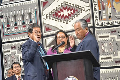 Former Chief Justice Herb Yazzie (right) administers the oath of office to Russell Begaye May 12 in Fort Defiance, Arizona. Photo/Marley Shebala