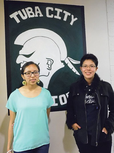 Tuba City High School 2015 Valedictorian Darshina Yazzie,  (left) will attend Dartmouth on a full scholarship to study engineering in the fall. Yazzie is a Chief Manuelito Scholar and is a member of the Native National Honor Society.  Salutatorian Kyra Kaya (right) will attend Coconino Community College this fall and is also a member of the Native National Honor Society. Yazzie and Kaya will deliver their commencement addresses May 23 at Warrior Pavilion in Tuba City. Photo/Rosanda Suetopka