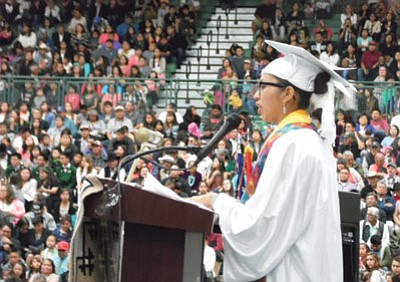 Tuba City High School 2015 Valedictorian Darshina Yazzie gives her address to the capacity crowd at the Warrior Pavilion May 23. Photo/Rosanda Suetopka