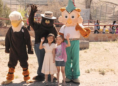 Kids enjoy the company of Eddie the Eagle, Smokey the Bear and Woodsy Owl at the Navajo Nation Zoo. Photo/Geri Hongeva