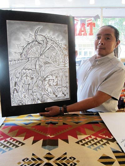 Lomayumtewa Ishii displays some of his artwork at Tam's Pendleton Art Jewelry in Flagstaff. Katherine Locke/NHO