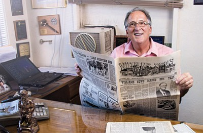 Navajo-Hopi Observer and Williams-Grand Canyon News Publisher Doug Wells looks through some old editions of the papers. Ryan Williams/NHO