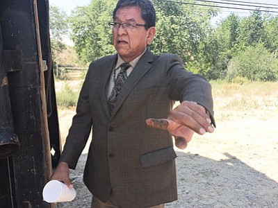 Above and below: Navajo Nation President Russell Begaye holds up a finger showing what appeared to be oil residue on water delivered by the U.S. Environmental Protection Agency to farmers in the Shiprock area. Samples and testing of all water tanks is in process. Photo/Rick Abasta